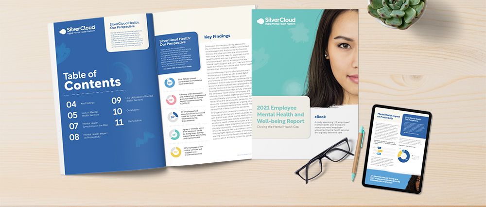 An open booklet all about SilverCloud Health and a sheet about the 2021 Employee Mental Health and Well-being Report.