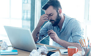 stressed-man-in-work-small